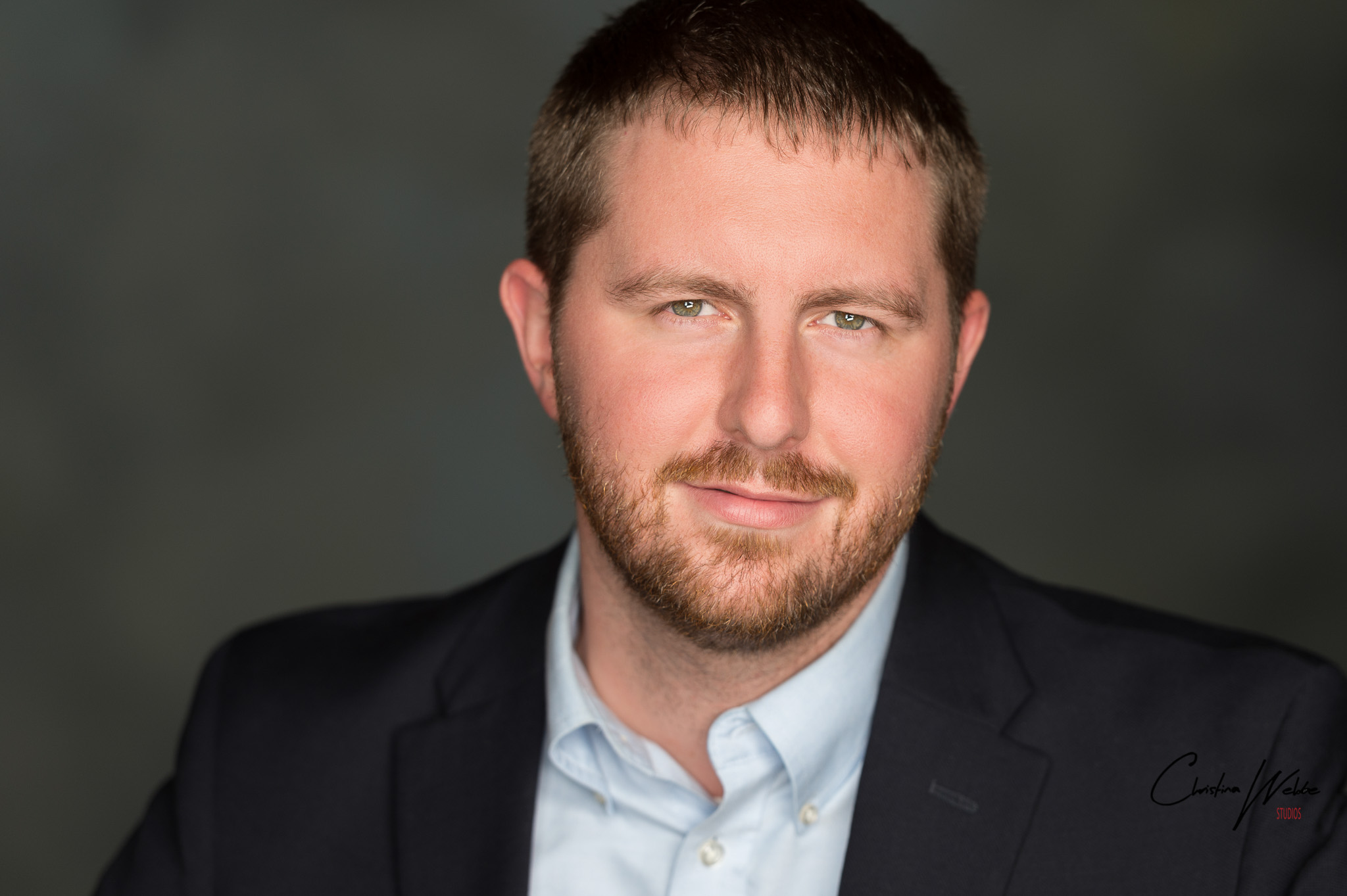 Orange County man in a suit posing for a headshot